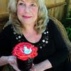 Newburyport: Paula Jorgenson with her Cup of Kindness, a jar of blueberry jam. Bryan Eaton/Staff Photo