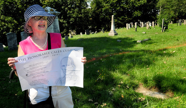 Newburyport: Mary Haslinger with the template for a bronze plaque to be placed at bottom right of photo to direct people to Caleb Cushing's gravestone in the Highland Cemetery in Newburyport. Bryan Eaton/Staff Photo