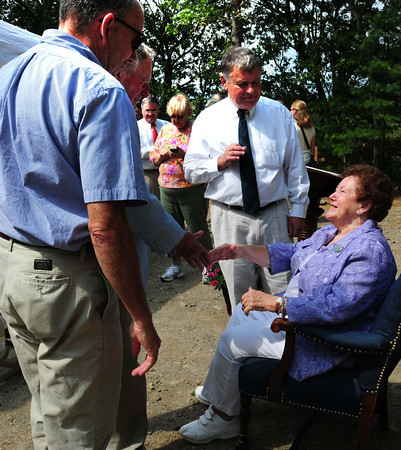 Newbury: Well wishers greet Topsfield artist and outdoor sportswoman Nancy Begin at a surprise dedication outlook named for her at the William Forward Wildlife Management Area on Hay Street in Newbury near Kent's Island. Bryan Eaton/Staff Photo