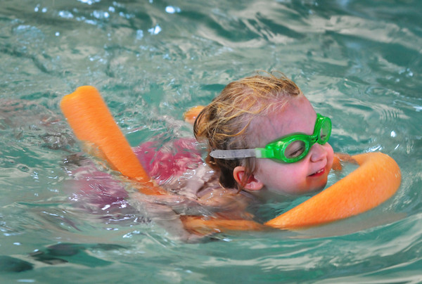 """Newburyport: Lilah Ananian-Randall, 3, of Georgetown paddles along in her """"noodle"""" at the YWCA pool yesterday afternoon. She was in the preschool class for beginners. Bryan Eaton/Staff Photo"""
