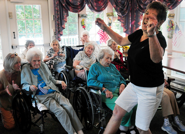 Newburyport: Phyllis Packer, visiting the Brigham Manor, dances to the music of the Dick Kaplan Excellent Jazz Band in the Nursing Home Concert Series. Bryan Eaton/Staff Photo