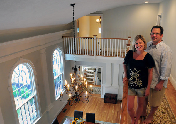 Newburyport: Owners Allison and Bob Morris kept the original windows and trim with the curved ceiling of the former First Church of Christ Scientist as they made the High Street, Newburyport landmark their home. Bryan Eaton/Staff Photo