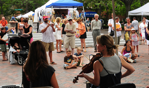 Newburyport: Molly and the Misfists perform for a crowd on Inn Street for the Yankee Homecoming Downtown Entertainment. Bryan Eaton/Staff Photo