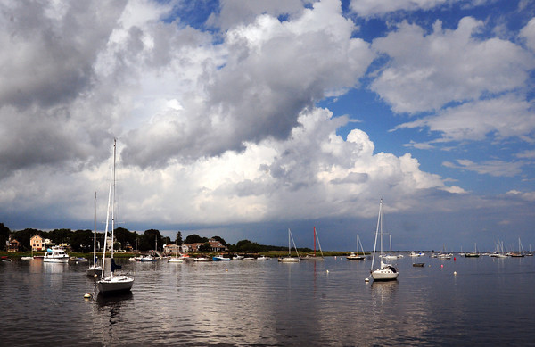 Newburyport: Puffy clouds gave way to darker clouds, rain and a clap of thunder over the Merrimack River yesterday afternoon. Rain returns tonight and tomorrow with clearing and drier weather starting on Thursday. Bryan Eaton/Staff Photo