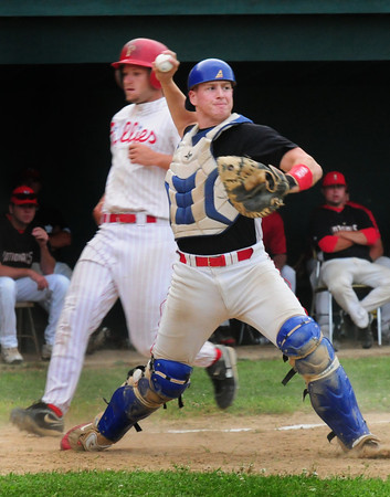 Amesbury: Newburyport Nationals' catcher Jared Notargiacomo throws to first for a double play as North Shore's Chris Blydell comes to home too late. Bryan Eaton/Staff Photo