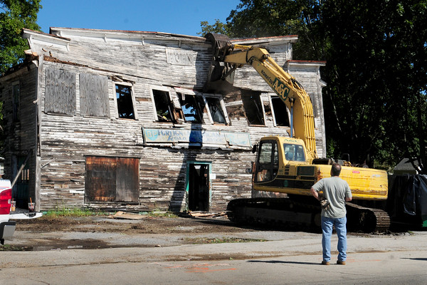 Amesbury: This landmark building on Friend Street in Amesbury that was a BP gas station was knocked down Monday morning. The building, which is near Whitehall Road, was ordered down for safety concerns. Bryan Eaton/Staff Photo