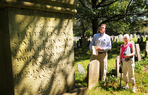 Newburyport: Jim Dyer, left, and Mary Haslinger of the Committee to Rediscover Caleb Cushing, Newburyport's first mayor among a holder of other political offices, stand at his gravesite at Highland Hill Cemetery in Newburyport. Bryan Eaton/Staff Photo