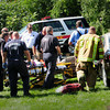 Newburyport: Newburyport rescue personnel remove a woman from a vehicle involved in a collision with another on Low Street yesterday afternoon near the entrance to Anna Jaques Hospital. Bryan Eaton/Staff Photo