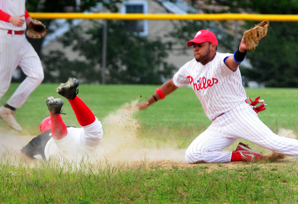 Amesbury: Newburyport Nationals' Scott LaValley, feet in the air, steals second past North Shore second baseman Lymbell Guerra. Bryan Eaton/Staff Photo