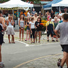 Newburyport: Spectators cheer on the runners of the Yankee Homecoming 10 Mile Race as they head through Market Square. Bryan Eaton/Staff Photo