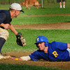 Rowley: Rowley Ram Jordan Silva makes it back to first past first baseman Mike Cain on a steal attempt. Silva eventually scored a run after a succesful steal and hit. Bryan Eaton/Staff Photo