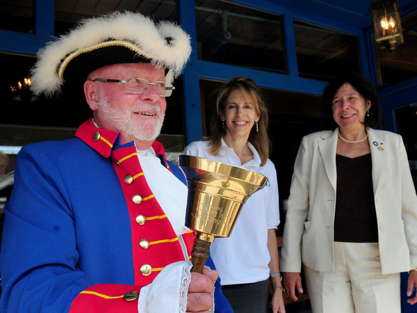 Newburyport: Yankee Homecoming Town Crier Zack Longley, was spotted in the downtown with Yankee Homecoming Chairman Cheryl Munick and Newburyport Mayor Donna Holaday. Bryan Eaton/Staff Photo