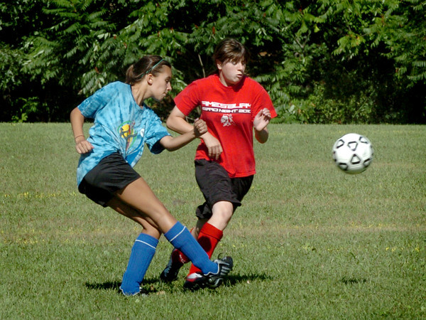 Georgetown: A Georgetown soccer player, left, and Amesbury player go after the ball during the two team's scrimmage yesterday at Georgetown High School. Bryan Eaton/Staff Photo