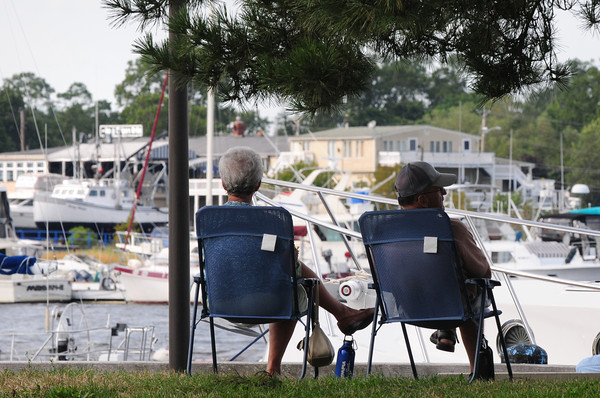 """Newburyport: Rose and Maurice Desrosier of Methuen check out the river traffic on the Merrimack River in downtown Newburyport on Wednesday afternoon. They come to the city a couple times a month and call it their """"get away place."""" Bryan Eaton/Staff Photo"""
