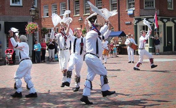 Newburyport: The Morris, or Morrice, Dancers performed in Newburyport's Market Square yesterday afternoon. Morris Dancing is an old English tradition which was thought to bring prosperity and luck in the communities they performed in. Sonya Vartabedian/Staff Photo