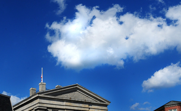 Newburyport: The flag atop the Custom House Maritime Museum in downtown Newburyport sits still below fair weather clouds Friday, a far contrast than what is expected as Hurrican Irene passes through tomorrow. Bryan Eaton/Staff Photo