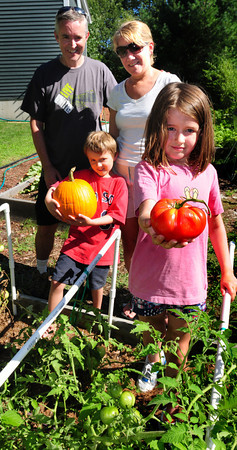 Newburyport: Nile and Katherine Robinson, with children Brendan, 6, and Sarah, 9, are trying to be as self-sufficient as they can with their garden produce. Bryan Eaton/Staff Photo