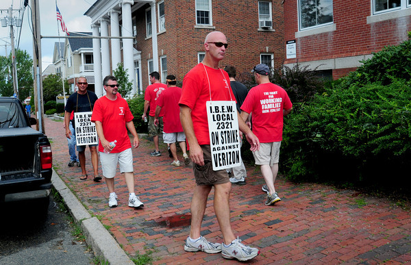 Newburyport: Verizon union workers picket outside the local office on Green Street in Newburyport yesterday afternoon. Bryan Eaton/Staff Photo