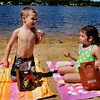 Amesbury: Preston Swain, 4, of Haverhill and Briana O'Flaherty, 5, of Amesbury chat during a picnic during yesterday's nice weather. The cousins were at Lake Gardner Beach with family where the crowds were diminished as children get ready for school. Bryan Eaton/Staff Photo