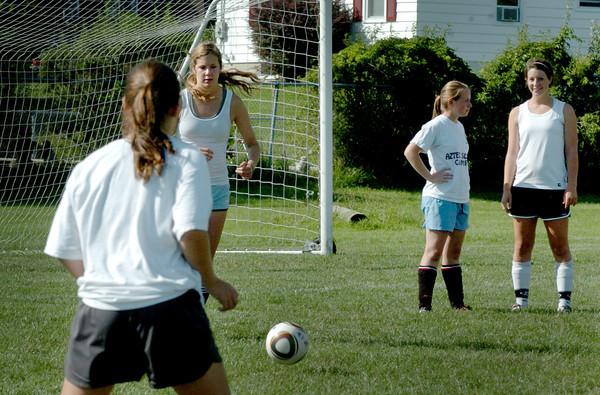 Newburyport: The Newburyport High girls soccer team runs through some drills yesterday afternoon at Fuller Field. Bryan Eaton/Staff Photo