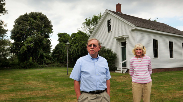 Newbury: Lon Hachmeister, left, and Joanie Purinton are part of a group trying raise the funds to buy property adjacent to Newbury's Lower Green. The land at present, to the rear of the trees at left, is slated to become a three-home subdivision. Bryan Eaton/Staff Photo