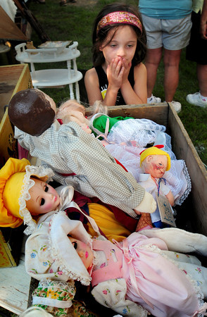 Newburyport: Lilly Brunnick, 5, of Newburyport checks out some antique dolls at the Annual Antique Show and Sale at the Belleville Church. Bryan Eaton/Staff Photo