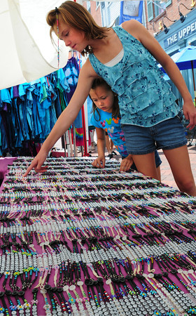 Newburyport: Lauren Schultz, 10, of Bradford and her younger sister Jillian, 5, check out handmade bracelets at the Market Square Craft Show. Bryan Eaton/Staff Phoo