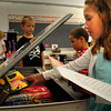 Salisbury: Stasi Krafton, 7, empties her backpack of supplies into her desk in Kelly Clayton's class at Salisbury Elementary School yesterday. It was the first day of classes for schools in the Triton Regional District. Bryan Eaton/Staff Photo