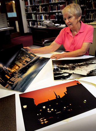 Newburyport: Volunteer Clarice Andreozzi, of the Newburyport Public Library's Archival Center, looks through some cityscapes taken by the late Fran Dalton from the photo collection she donated to the library. Bryan Eaton/Staff Photo