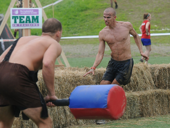 Amesbury:Elliot Megquier gets through the final obsticle, a warrior, in the Spatran Race at Amesbury Sports Park Saturday. Jim Vaiknoras/Staff photo