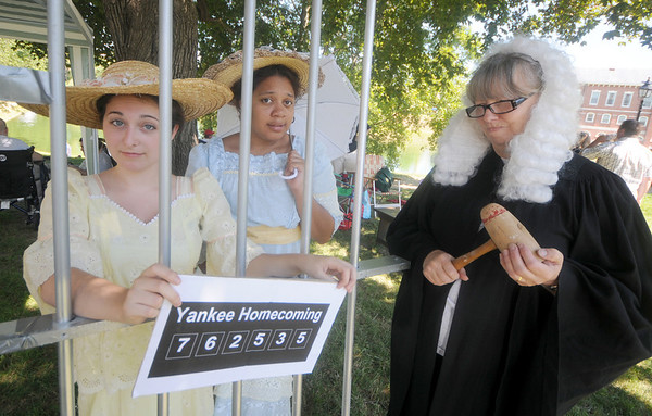Newburyport: Prisoners Brook Lavoie and Orlik Guzman are held in the Kangaroo Court Jail by Susan Sander at Yankee Homecoming's Old-Fashioned Sunday on the Mall. The trio is from the Top Notch Players, a theater group at Northern Essex Community College. Jim Vaiknoras/Staff photo