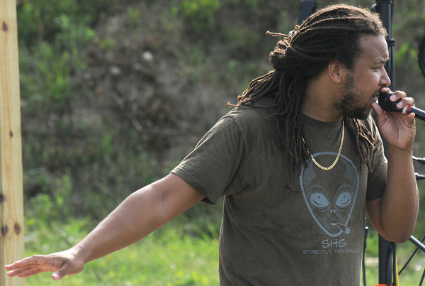 Amesbury: Kevin Mark Holness performs with Mighty Mystic at the Festevolve Music festival at the Amesbury Sports Park Saturday . jim Vaiknoras/Staff photo