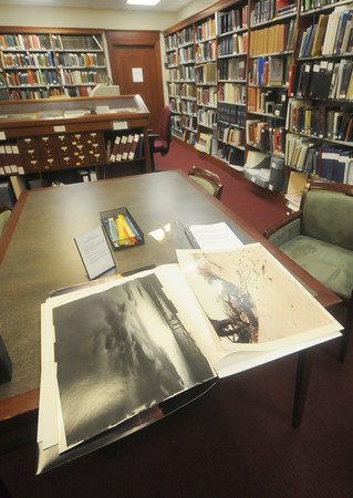 newburyport: Some of the photos by Newburyport photographer Fran Dalton in the archive room at the Newburyport Library. Jim Vaiknoras/Staff photo