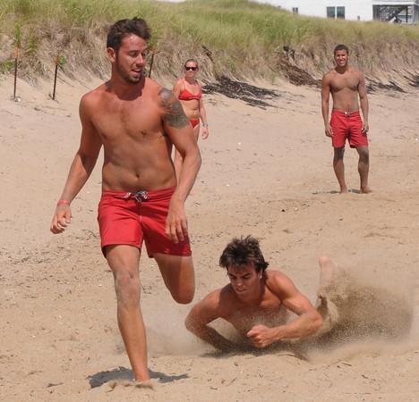 Salisbury: Tony Lambertson beats out Anthony Blake  during the Life Guard Games at Salisbury Beach Thursday. Jim Vaiknoras/Staff photo
