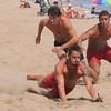 Salisbury: Tony Lambertson beats out Anthony Blake and Eric Rodriquez in a race duirng the Life Guard Games at Salisbury Beach Thursday. Jim Vaiknoras/Staff photo