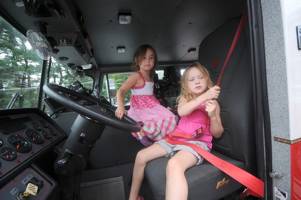 Wenham: Grace Brown, 4, and her sister Tory, 5, check out one of the fire trucks at the annual  BBQ at the Wenham fire station Saturday morning during <br /> Wenham Museum's 39th annual Family Festival and Craft Fair<br /> <br /> <br />  Jim Vaiknoras/Staff photo