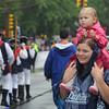newburyport: Justina Bucknill, 2, gets a vantage point from her mom Margret's shoulders in the rain at  the Yankee Homecoming Parade Sunday. JIm Vaiknoras/staff photo