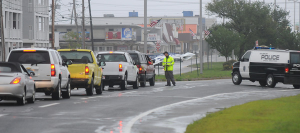 Salisbury: A Salisbury police officer stops traffic headed to the beach Sunday. The beach was closed and drivers had to prove residency to pass. Jim Vaiknoras/Staff photo