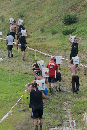 Amesbury: Runners buckets of gravel up and down the hill in the Spatran Race at Amesbury Sports Park Saturday. Jim Vaiknoras/Staff photo