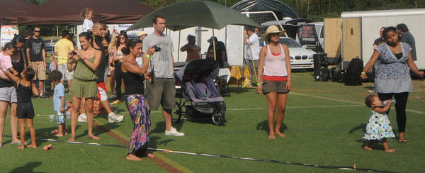 Amesbury: Kids and adults dance and take pictures  at the Festevolve Music festival at the Amesbury Sports Park Saturday . jim Vaiknoras/Staff photo