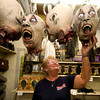 Salisbury: Judy Fogel, an employee at Tom Discount Store in Salisbury, works on a display of fake severed heads as the store gets an early jump on Halloween. Jim Vaiknoras/Staff photo