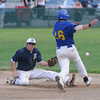 Rowley: Manchester's Whit Graham can't get the handle on the throw as Rowley's Jordan Silva steals second during their game at Eiros Field in Rowley. Jim Vaiknoras/Staff photo