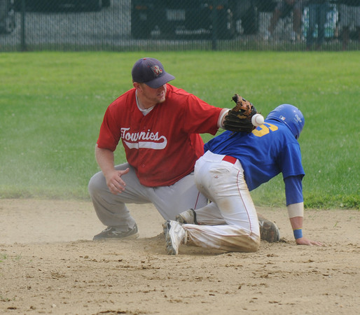 Rowley: Rockport shortstop Jeremy Spitle can't get a hold of the ball as Rowley's Jorday Silva steals second during their game at Eiras Field in Rowley Saturday. Jim Vaiknoras/Staff photo