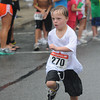 Newburyport: Newburyport's Benjamin St. Lawrence of Newburyport , finishes the High Street Mile/ Jim Vaiknoras/Staff photo