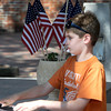 Newburyport: Jack Szczuka, 9, plays piano on Inn Street Friday afternoon. Jack studies at the Musical Suite and is the recipiant of their Directors Award. JIm Vaiknoras/Staff photo