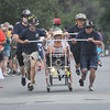 Newburyport: The team from The Newbury Fire Dept sprints to the finish in the Yankee Homecoming Bed Race on Federal Street Thursday night. JIm Vaiknoras/Staff photo