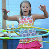 Seabrook: Kailyn Fowler, 7, uses 2 hulu hoops at once during the hula hoop contest, at Seabrook Old Home Days Saturday at Seabrook Elemetary School. Jim Vaiknoras/Staff photo