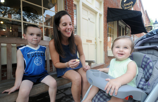 Newburyport: Kylie Dupuis, 1, finishes her ice cream cone with her mom Jamie and her brother Luke at Simply Sweet on Inn Street in Newburyport Thursday. The family live in Haverhill and visit Neburyport often. Jim Vaiknoras/Staff photo