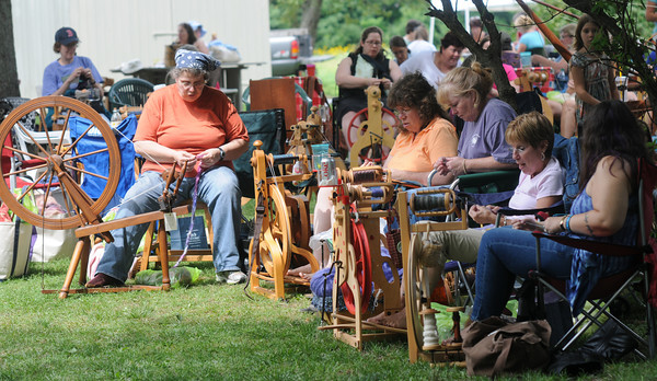 Newbury: Spinners make yard from wool at the annual Fiber Revival at Spencer Peirce Little Farm Saturday. The all day event also features 1861 rules baseball as well as alpacas, and spinning demonstrations. Jim Vaiknoras/Staff photo