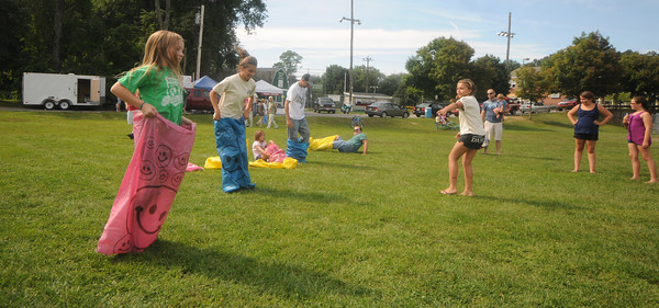 Merrimac:Runners in the sack race head to the finish line at Merrimac Old Home Days at the Donahue School Saturday morning. Jim Vaiknoras/Staff photo